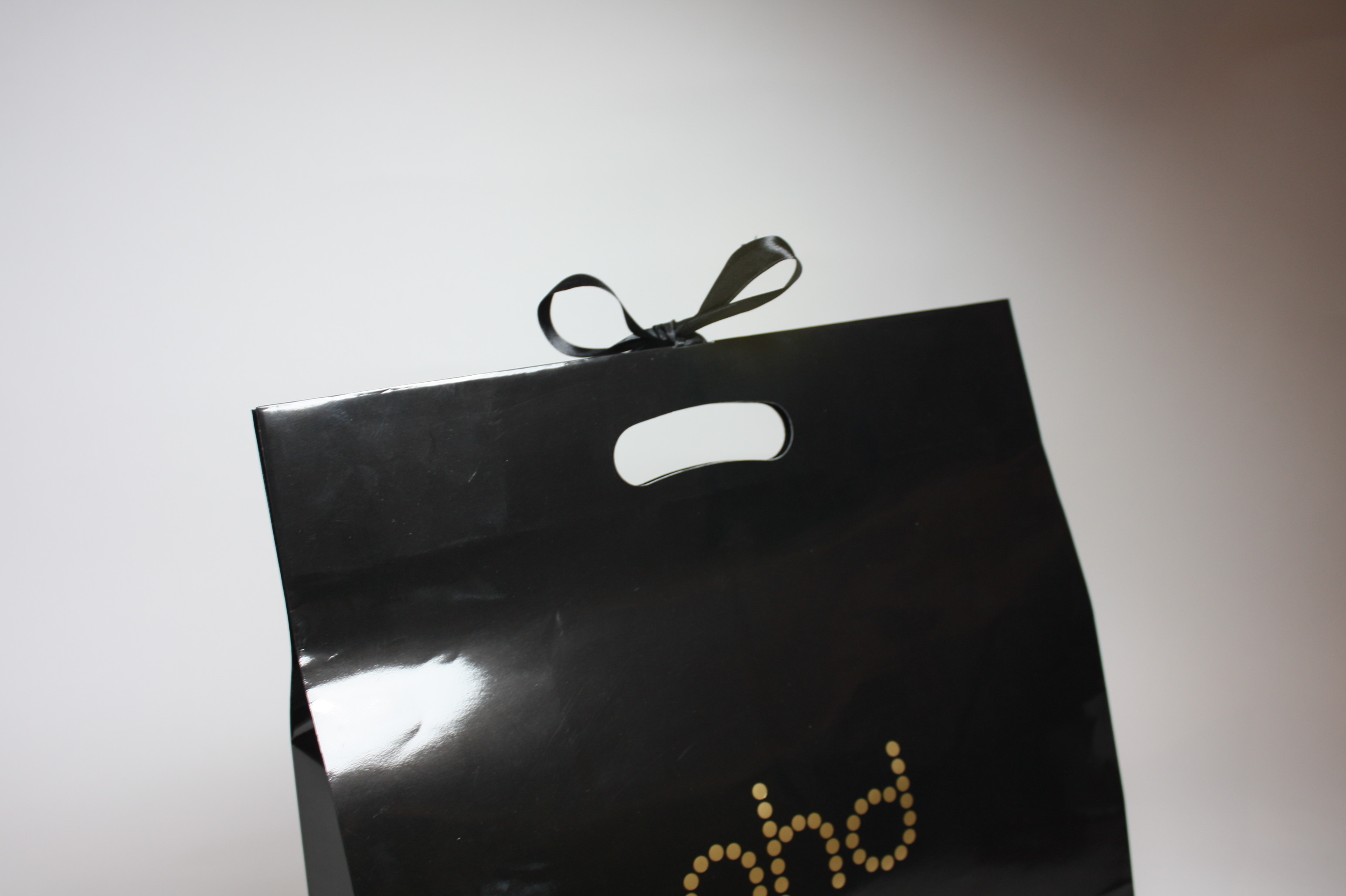 Die cut bag with ribbon attached